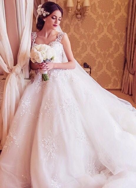 2021 Ball Gown Wedding Dresses Straps Sparkly Crystals Beaded Puffy Luxury Bridal Gowns